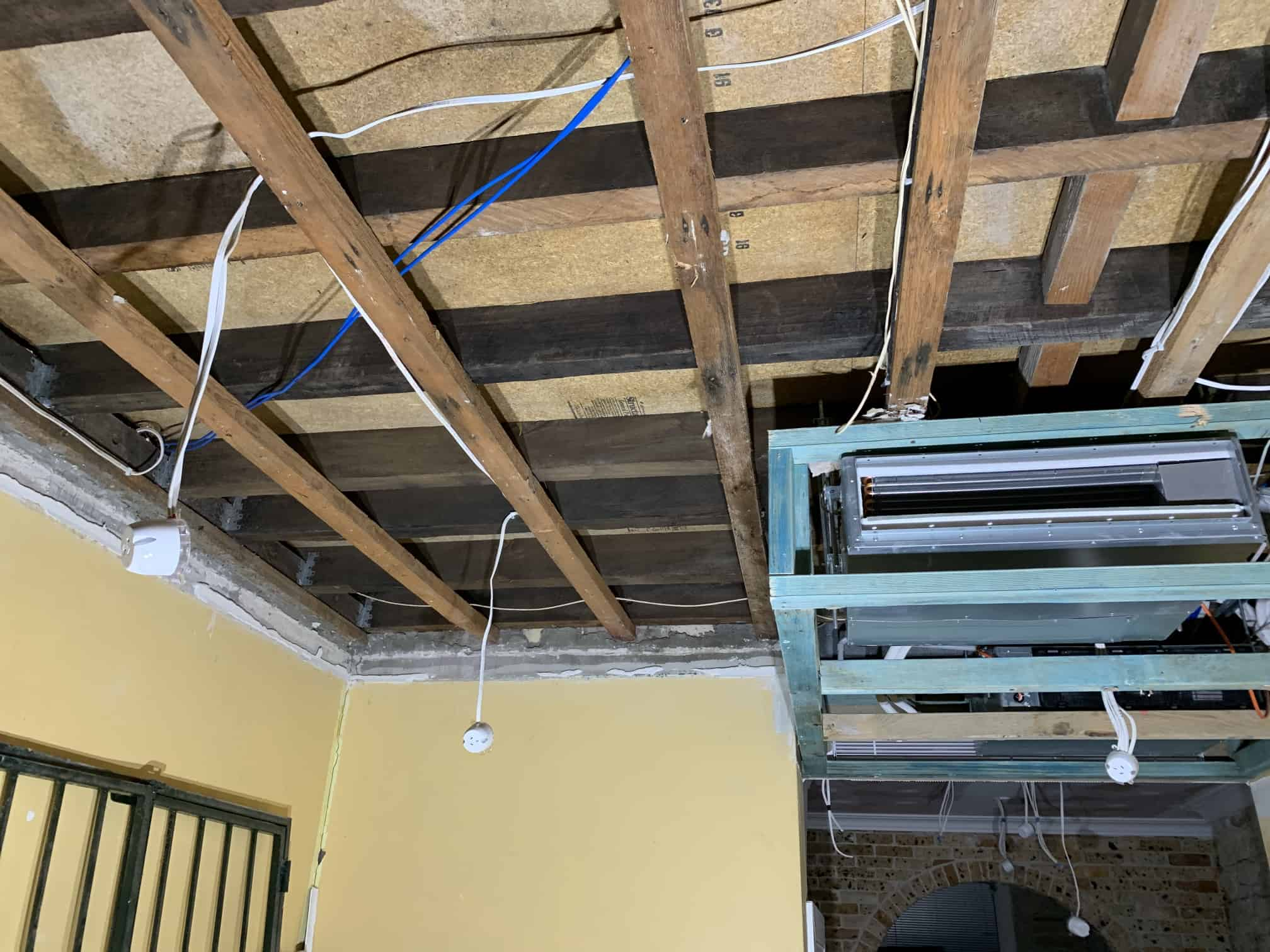 wooden ceiling with wires and cables