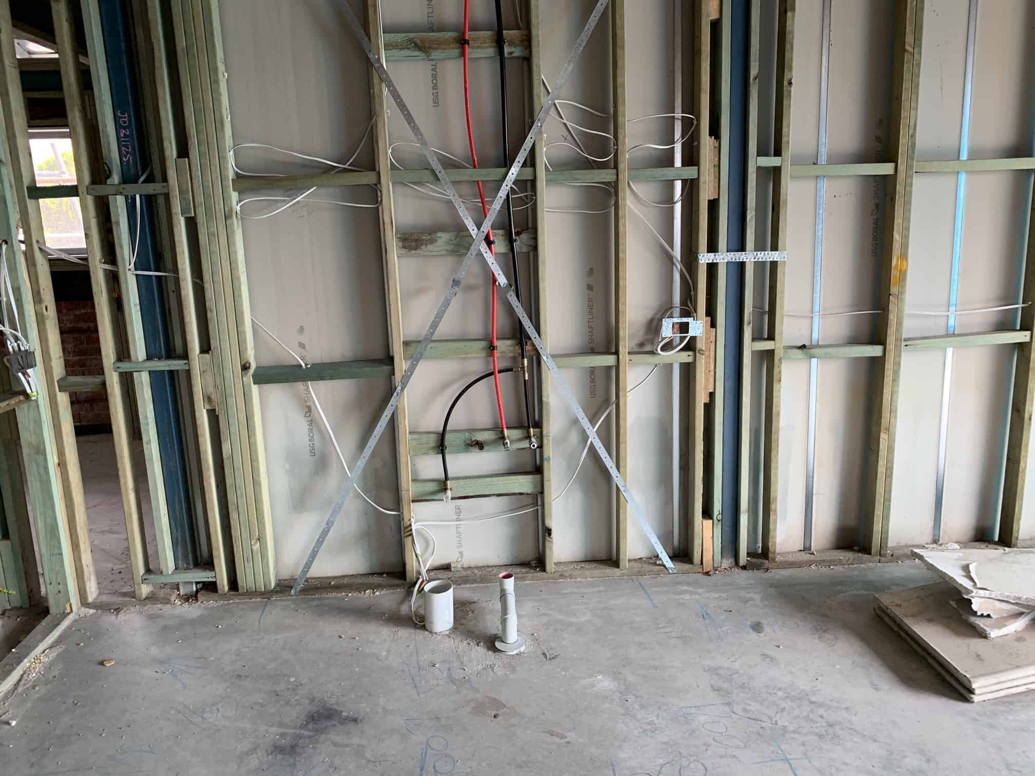 wires on wooden wall frame