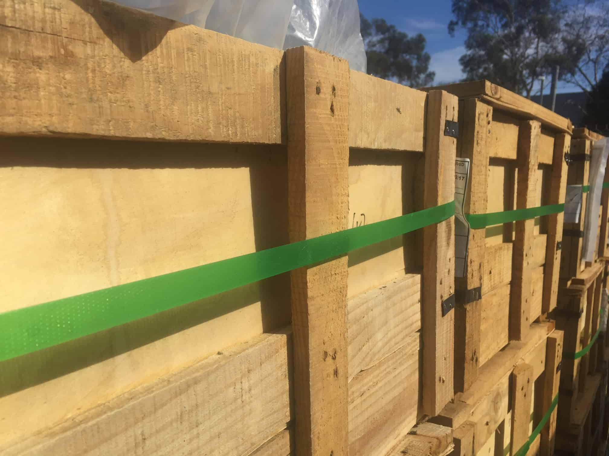 wooden boxes with green ties